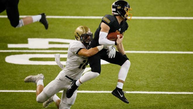 Bettendorf's Carter Bell (11) is tackled by Iowa City, West's Cole Mabry (18) during their 4A state semi-final football game at the UNI Dome on Friday, Nov. 10, 2017, in Cedar Falls. Iowa City, West would go on to win 23-0 to advance to the state finals.
