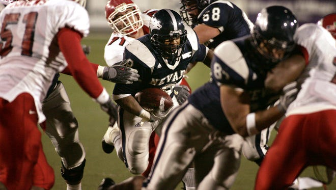 Nevada's B.J. Mitchell runs up the middle against Fresno State in the Wolf Pack's upset win in 2005.