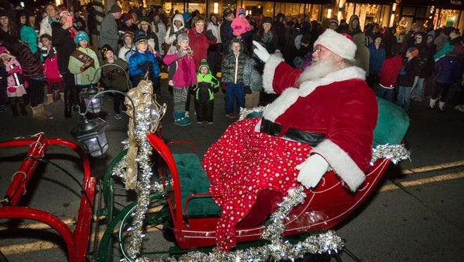 Santa arrives with a hearty greeting at a previous Whitefish Bay Holiday Stroll and Parade. This year's event is set for Friday, Nov. 24.