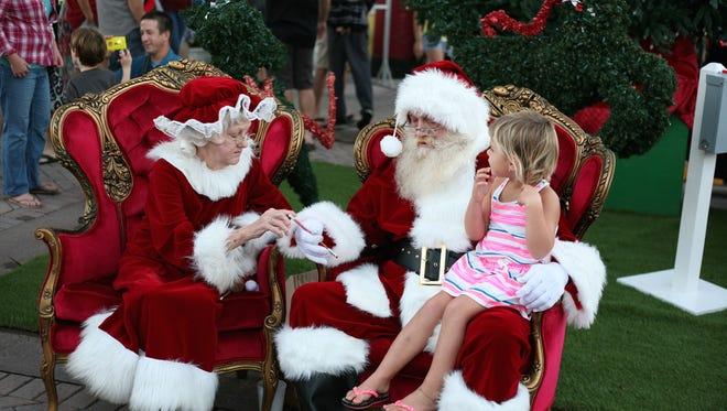Visit with Santa and Mrs. Claus at Christmas on Main Street and take DIY photos!