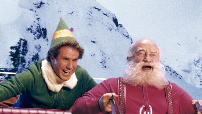 """Buddy (Will Ferrell) gets a ride with Santa (Ed Asner) in """"Elf."""""""