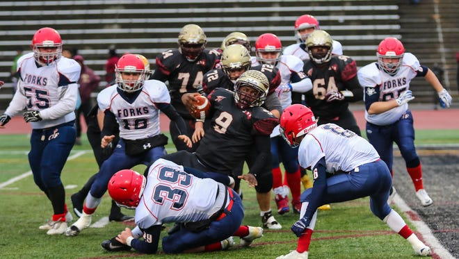 Chenango Forks' Connor Borchardt smack in the middle of the action in Chenango Forks' 48-28 semifinal victory Saturday over Cheektowaga.