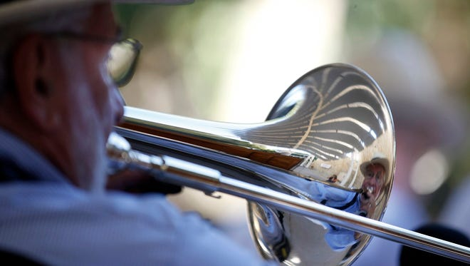 Art Blatt plays the trombone for the Naples Dixieland Jazz Band during a concert at Cambier Park on Sunday, November 3, 2013 in Naples.