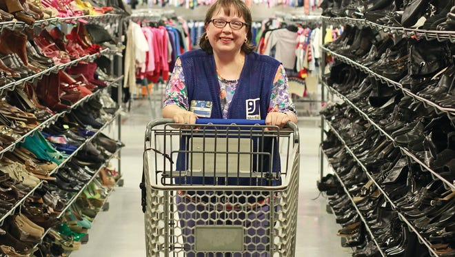 Mary Matlock enjoys her 'workplace family' at the Goodwill store in Lawrenceburg.