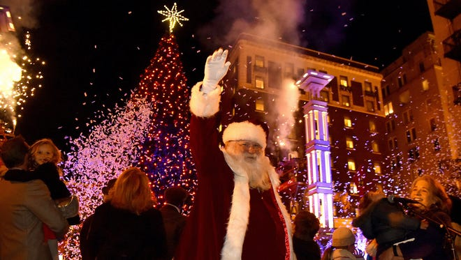 Santa Claus waves to the crowd at the lighting of the Christmas tree at the Christmas in the City kickoff, the Regal Celebration of Lights, in downtown Knoxville on Nov. 24, 2017.