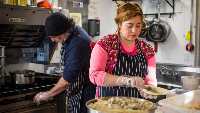 From left, Carlos Hutchinson, owner of Tlaolli, prepares tamales with daughter, Jennifer Delgadillo, on Friday, Dec. 08, 2017.
