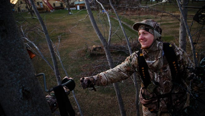 Jasen Hammer, 27 of Grimes, celebrates with fellow hunter Michael Schneider, 36 of Grimes after they each shot a deer on Friday, Dec. 15, 2017, in Urbandale. The pair are two of the 12 hunters the City of Urbandale contracts with to hunt deer within the city limits.