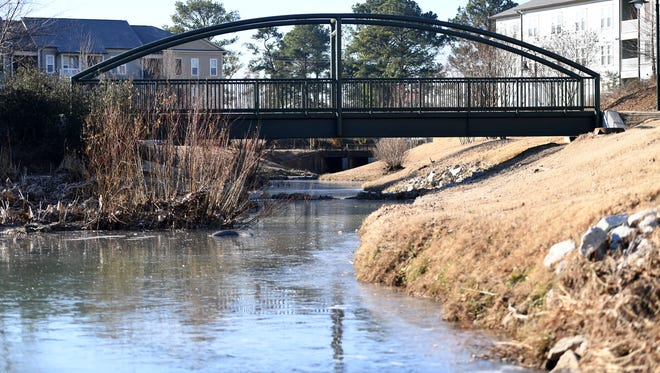 Below freezing temperatures caused the creek at Jackson Walk to ice over. Warmer temperatures are expected this weekend.
