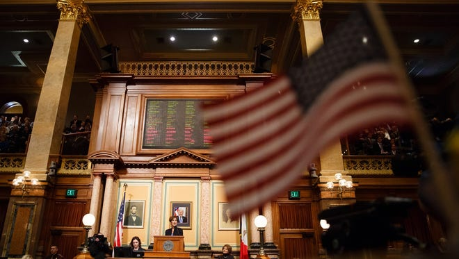 Gov. Kim Reynolds address the Iowa Legislature during her first Condition of the State address on Tuesday, Jan. 9, 2018, in Des Moines.