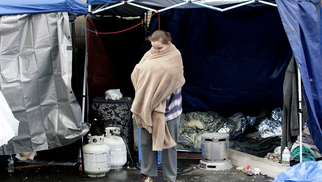 Jamie Veley stands in front of the temporary shelter she stayed in Wednesday night. Veley usually stays at the downtown Bremerton Salvation Army, but an outbreak of bed bugs forced closure of the shelter on Wednesday. It is expected to reopen on Friday.