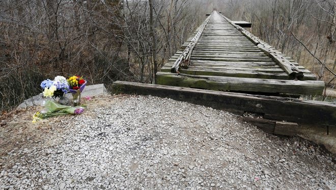 Flowers next  to Monon High Bridge in memory of Liberty German and Abigail Williams  Tuesday, February 21, 2017, on the Monon High Bridge Trail just east of Delphi. German, 14, and Williams, 13, were hiking the Delphi Historic Trails the afternoon of February 13, but did not show up when relatives arrived later to pick them up. The girls were reported missing at 5:30 p.m. Their bodies were discovered by searchers about 12:15 p.m. Tuesday east of High Bridge and about 50 feet north of Deer Creek.
