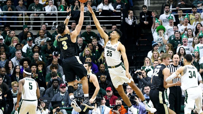 Michigan State's Kenny Goins, right, challenges Purdue's Carsen Edwards during the first half on Saturday, Feb. 10, 2018, at the Breslin Center in East Lansing.