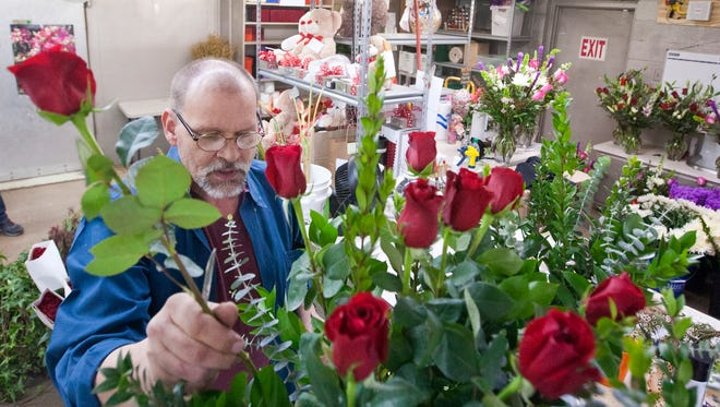 Kelly Fields arranges a bouquet of flowers in preparation for Valentine's Day at Mark Knox Flowers in Odessa, Texas, on Saturday, Feb. 10, 2018. Fields has been a florist for over 30 years.