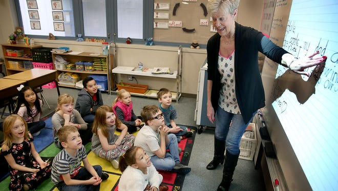 Ann Gresley, first-grade teacher at Hidden Creek Elementary School in Port Orchard, leads her class in a reading and spelling project.