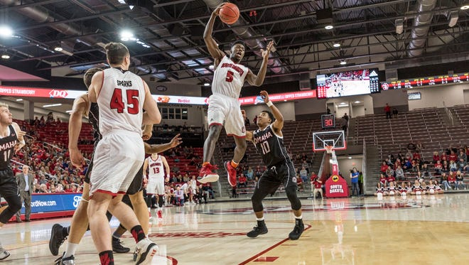 Joshua Doss gathers in a rebound vs. Omaha on Saturday at the Sanford Coyote Sports Center.