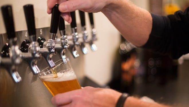 Greg Bentley, co-owner of Black Cap Brewing Company, pours a beer. Black Cap Brewing Company brewpub in Red Lion in 2015.