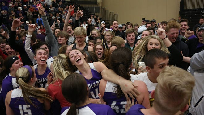 Indianola fans and players celebrate the Indians' state tournament berth. Indianola won at Southeast Polk Tuesday to earn a spot in the Class 4A state tournament field.