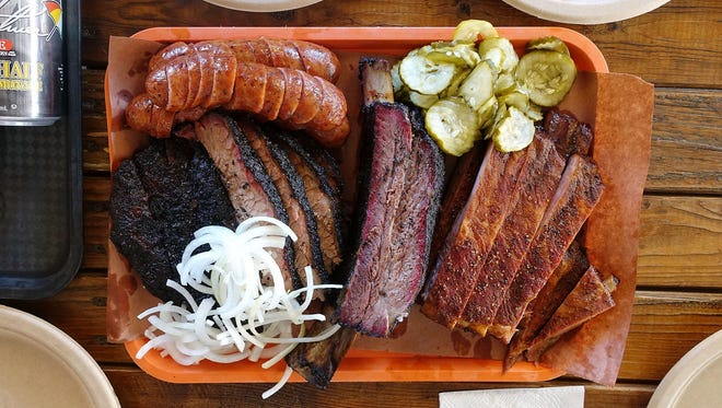 A selection of barbecue (from top left: sausage, fatty brisket, beef rib, pork ribs) at Little Miss BBQ.