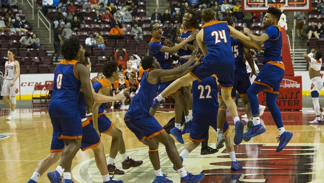 York High celebrates after the win. York High defeats Northeastern 84-80 in overtime in a District 3 Class 5A boys' basketball semifinal game at Giant Center in Derry Township, Monday, February 26, 2018.