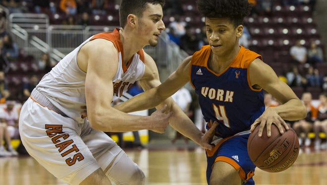 Northeastern's Antonio Rizzuto, left, defends York's Jaevon Woodyard, right. York defeats Northeastern 84-80 in overtime in a District 3 Class 5A boys' basketball semifinal game at Giant Center in Derry Township, Monday, February 26, 2018.