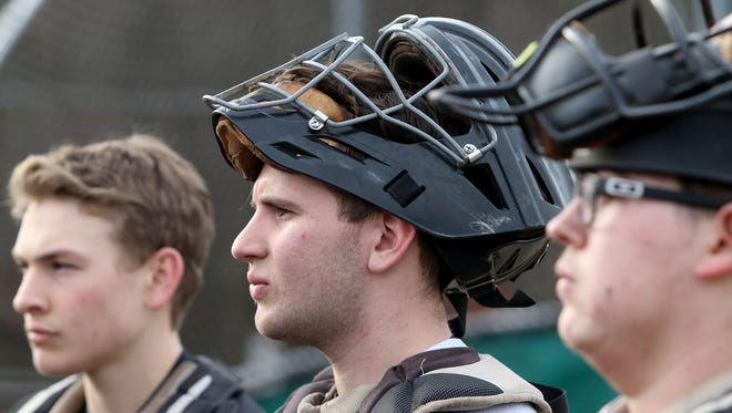 South Kitsap senior catcher Alex Garcia (center) is the Kitsap Sun's baseball player of the year for 2018. Garcia, who'll play at Edmonds Community College next season, was a four-year starter for the Wolves.