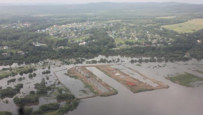 In this Aug. 15, 2013 file photo provided by the Russian Emergency Ministry, Khaabarovsk region branch, shows the aerial view of a flooded Amur River in the Khabarovsk region.