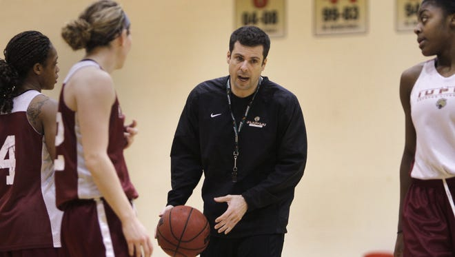FILE -- Coach Austin Parkinson talks to  the IUPUI women's basketball team during practice, in 2012