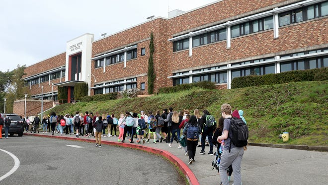 Students from Central Kitsap Middle School in Washington exit their school building for a memorial to victims of the Marjory Stoneman Douglas High School shooting.