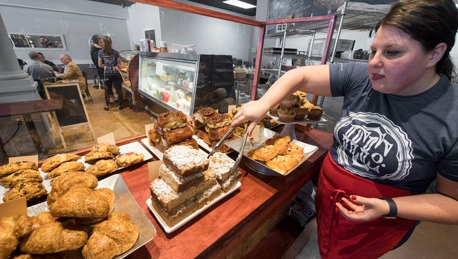 Nicole Austin arranges pastries at the Copper Crust in Spring Garden Township.