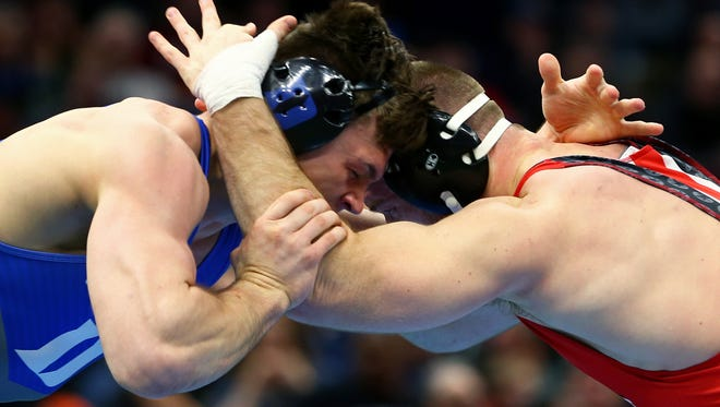 Lexington grad Jacob Kasper, a two-time All-American at Duke, locks horns with Ohio State's two-time NCAA champ  Kyle Snyder in the NCAA Championships.
