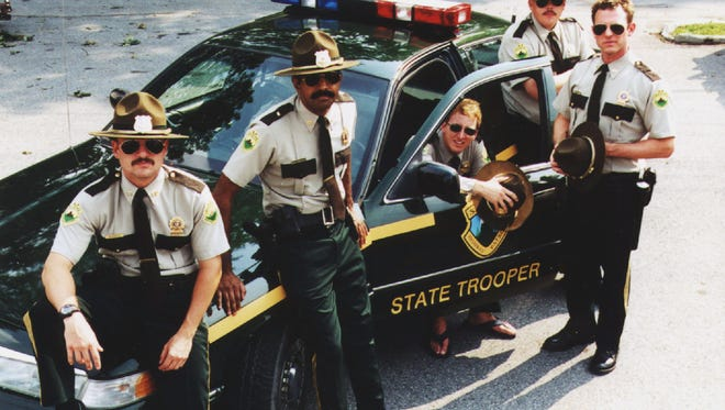 "This is the cast of the movie ""Super Troopers"" poised around a Vermont State Police cruiser in this undated handout photo."