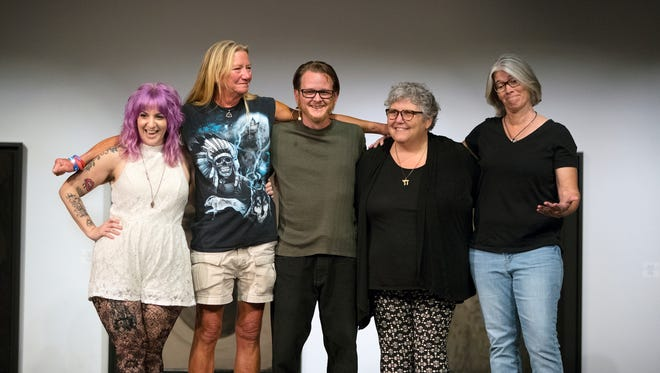 """Angela Page, left, Mary Dugan, Matthew Fread, Celia Rubin and Robyn George celebrate after sharing the stories behind their tattoos recently at the Southwest Florida Storytellers Project at the Sidney and Berne Davis Art Center in downtown Fort Myers. """"Tattoo Tales"""" was presented by The News-Press and The Naples Daily News. Go to tickets.news-press.com to learn about upcoming events."""