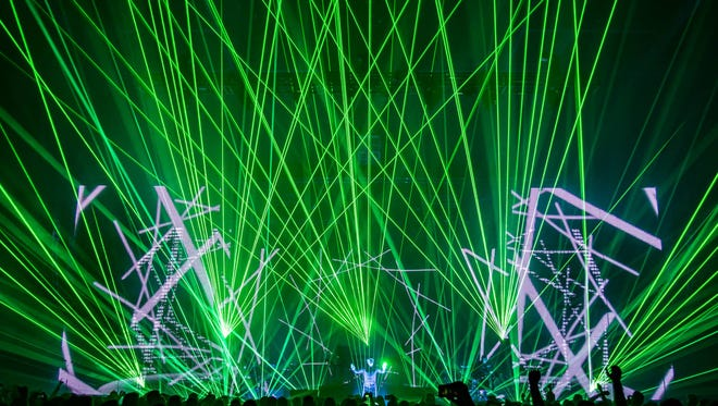 Jean-Michel Jarre intergrates electronic music and laser lights to deliver political messages on the Los Angeles leg of his Electronica World Tour. Photo by Eric Voake/Special to The Desert Sun