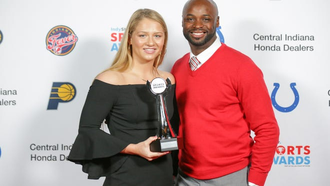 Girls Swimmer of the Year, Emily Weiss, of Yorktown, poses for a photo with former Indianapolis Colts wide receiver Reggie Wayne during the IndyStar Sports Awards at Butler's Clowes Memorial Hall on Sunday, April 29, 2018.