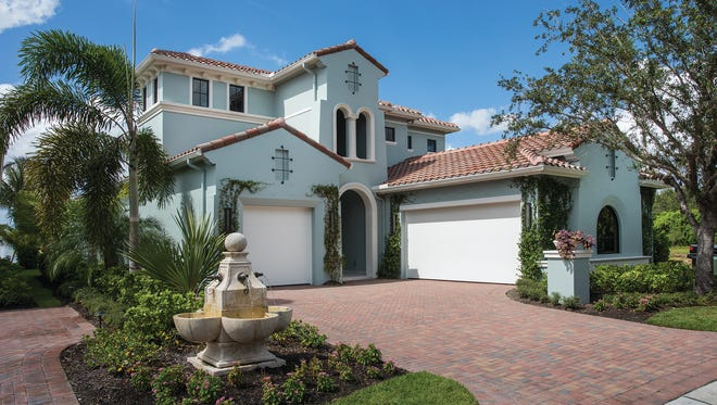 A free golf membership is included for a limited time with the purchase of Randall Mitchell Custom Homes' designer-furnished Highlands Golf Villa model at Miromar Lakes.
