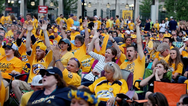 Fans cheer for the Predators during the watch party for game 7 of the playoff series between the Predators and Jets Thursday May 10, 2018.