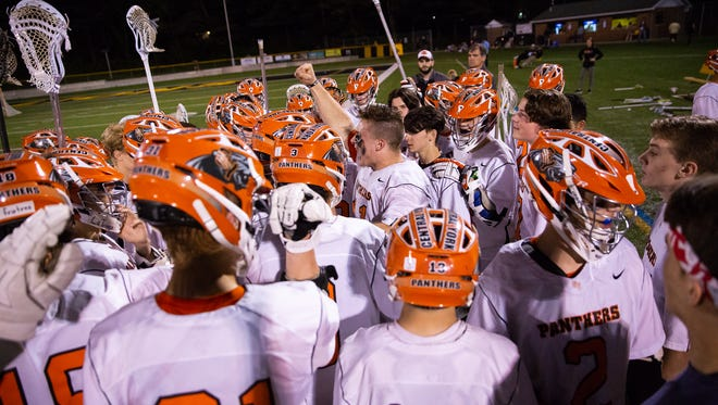 Central York's Kollin Vaught (41) gives a pep talk to his teammates after being injured during the YAIAA Boys Lacrosse Championship game between York Catholic and Central York, Friday, May 11, 2018 in Red Lion.