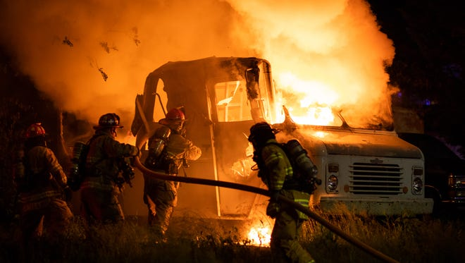 "Firefighters work at the scene of a fully involved box truck fire to the rear of the 400 block of High Street, Thursday, May 24, 2018 in Hanover. The fire was ""intentionally set by unknown persons,"" said Hanover Area Fire & Rescue Chief Tony Clousher."
