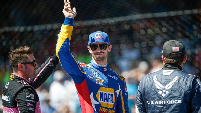 Andretti Autosport IndyCar driver Alexander Rossi (27) waves to the crowd during driver introductions prior to the 102nd running of the Indianapolis 500 at Indianapolis Motor Speedway on Sunday, May 27, 2018.
