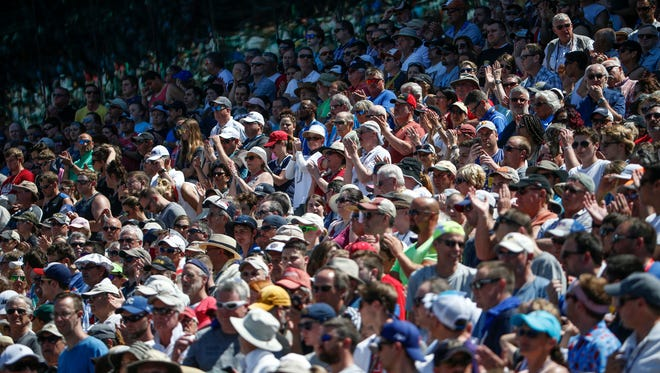 Fans cheer as the 102nd running of the Indianapolis 500 starts at Indianapolis Motor Speedway on Sunday, May 27, 2018.