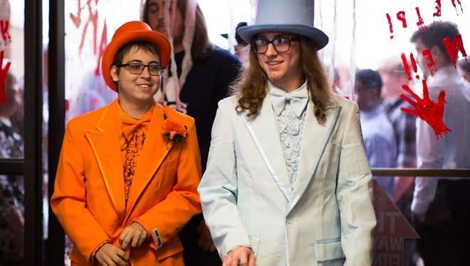 """Hanover senior Logan Scheivert (in orange) and best friend Nash Miller (in blue), dressed as characters from the movie """"Dumb and Dumber"""" enter the """"Night to Dismember"""" prom held by family and friends for Scheivert, Sunday, May 27, 2018 at Magic Elm in Hanover. Scheivert, 18, missed his senior prom due to being hospitalized from complications with his leukemia."""