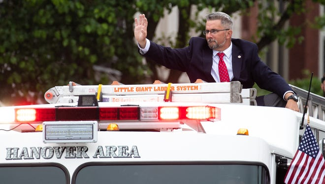 Mayor of Hanover Ben Adams waves from the back of Hanover Area Fire & Rescue's Truck 79-1 during the Hanover Memorial Day Parade, Monday, May 28, 2018 in downtown Hanover.