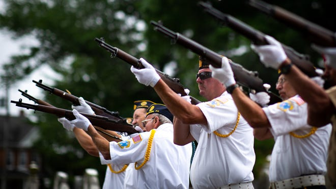 A 21 gun salute is fired off during a ceremony held following the Hanover Memorial Day Parade, Monday, May 28, 2018 at Mt. Olivet cemetery.