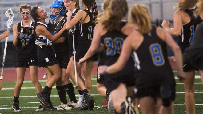 Kennard-Dale celebrates as the game ends. Kennard-Dale defeats Susquehannock 11-9 in their PIAA Class 2A girls' lacrosse semifinal game at Central York High School in Springettsbury Township, Tuesday, June 5, 2018.