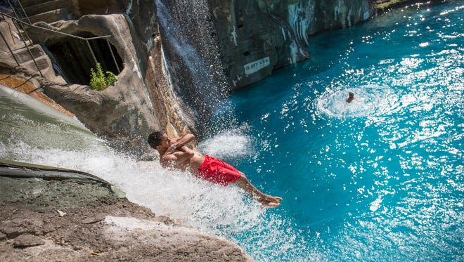 """A rider slides off Bombs Away at Mountain Creek Water Park in Vernon, N.J. The park formerly known as Action Park opens for its 2018 season on June 9 as a movie poking fun at its past, """"Action Point,"""" shows in theaters nationwide."""