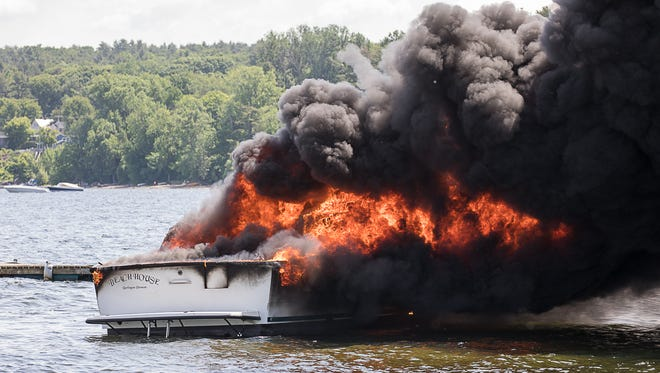 """The 31-foot private boat """"Beach House"""" burns in Inner Malletts Bay on Saturday, June, 9, 2018, in Colchester, Vermont."""