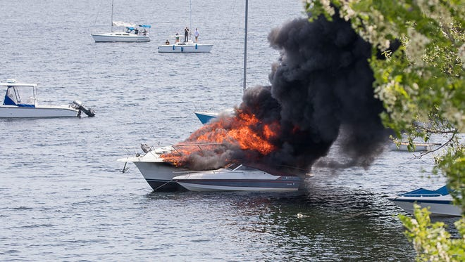 "The 31-footer ""Beach House,"" left, sets fire to the moored ""Little Italy"" on Inner Malletts Bay on Saturday, June 9, 2018, in Colchester."