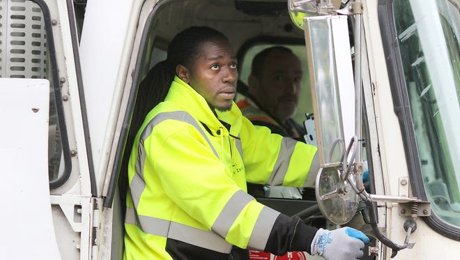 Waste Management driver in training DeAnthony Hale from Portland, Oregon uses his side mirrors during a test run on the Pacific Northwest Driver Training Center near the Bremerton Airport.