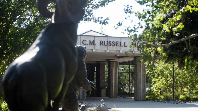 Bronze statues point to the C.M. Russell Museum entrance.