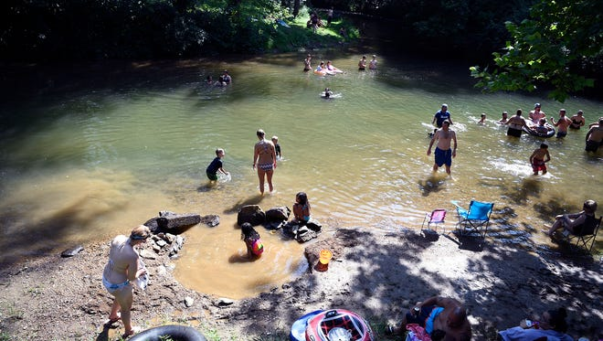 Yorkers spend a hot day cooling off in Muddy Creek at Muddy Creek Forks, Sunday, July 1, 2018, John A. Pavoncello photo